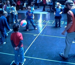 A goggled-Gabriel takes on some kids in four square