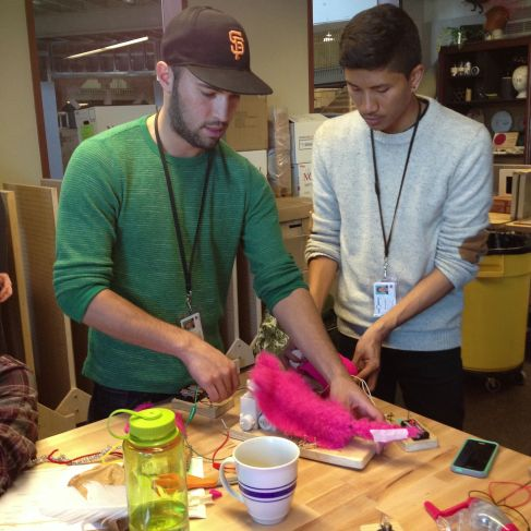 Having mastered the circuitry to move exposed toy-parts, Adrian & Jake cover their creation with pink fur.